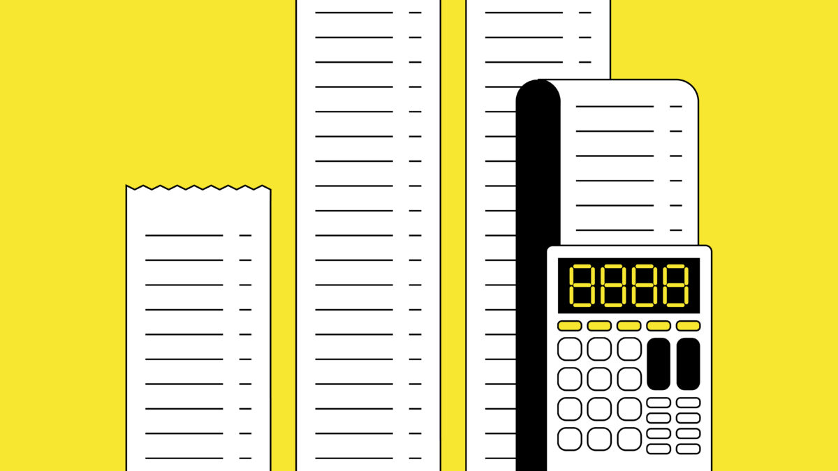 long document with a calculator on a yellow background
