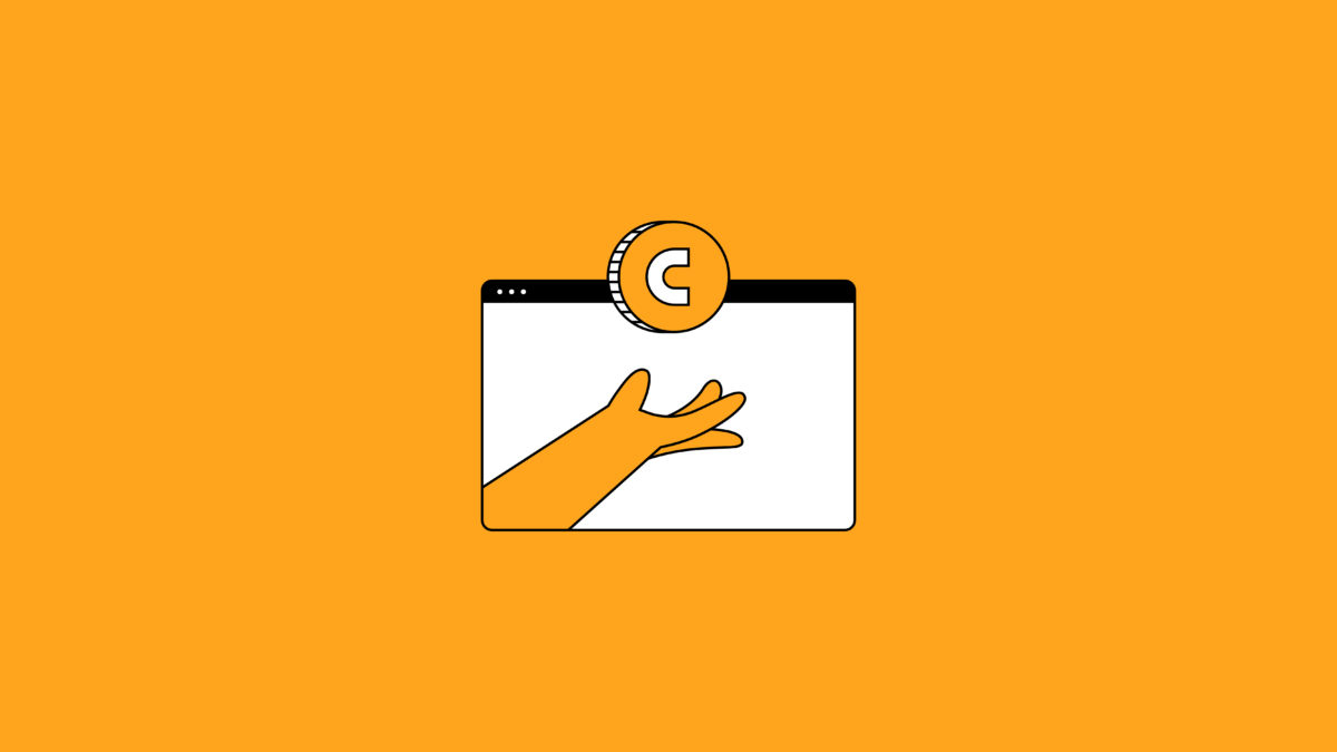 hand reaching out for a coin on a desktop screen on an orange background